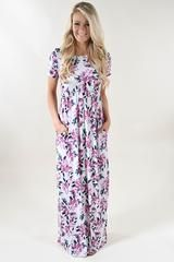 Purple top 3/4 sleeve maxi dress with a floral bottom.  Fit: True to size. Stretchy waist band.  Material: 95% Poly 5% Spandex  Model Stats: Hannah is 5'6'' a size 0 wearing a small.  Measurements:  Small: Bust 34'' Length 59''  Medium: Bust 36'' Length 59''  Large: Bust 38'' Length 59'' X-Large: Bust 40'' Length 59''