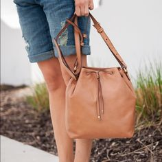 Banana Republic Bucket Bag Get ready for summer with this camel colored bucket bag. Purchased last year and I never used it. Great versatile bag with plenty of space for all your goodies. Banana Republic Bags Crossbody Bags