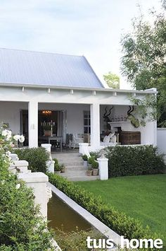 Beautiful white home with outdoor patios and lush green gardens Outdoor Rooms, Outdoor Living, Outdoor Patios, Porches, Modern Farmhouse, Farmhouse Style, Farmers Porch, Cape Style Homes, Farmhouse Architecture