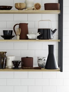 Black and terracotta kitchen accessories-love this collection of jugs, kettles and pots | Residence Magazine / Blooc kitchen : Photographer Kristofer Johnson…