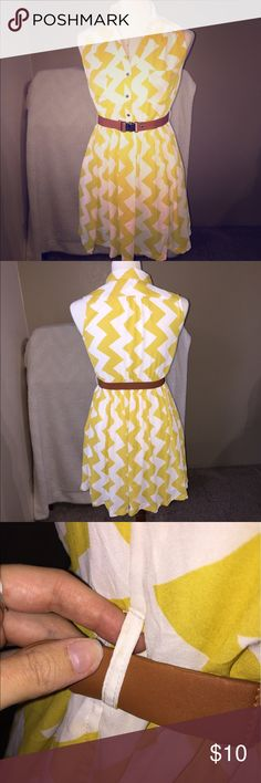 Yellow and white chevron sleeveless dress Bought this dress new from a boutique while on vacation, ripped the tags off, and put it in the back off my closet where it has been ever since. It's a cute dress, but maybe a bit impulsive and not quite my style :) I am definitely open to offers, or probly will just donate. The brown belt is a heavy buckle, and there are two small marks from being bumped around my closet, as shown in pictures 3 and 4. Thanks for looking! Dresses