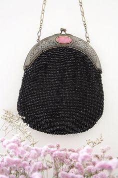 Antique, black glass beaded purse. Etsy from LaSatoria.
