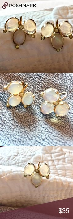 """VINTAGE White Moonstone earrings A stunning pair of Vintage translucent white moonstone  Screw in post clip-on earrings.  Three oval moonstones surrounded by 4 white rhinestones. Excellent Vintage condition.  Fully functioning post and no loose stones.  Earring post says """"Sterling"""" but they look like goldstone over Sterling. Vintage Jewelry Earrings"""