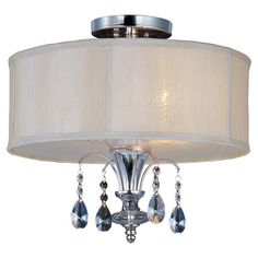 Cast a warm glow in your living room or entryway with this lovely flush mount, showcasing crystal drop accents and a fabric drum shade.