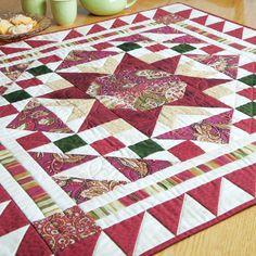 RED ROBIN: Patchwork Table Topper Quilt Pattern Designed by NANCY MAHONEY Welcome guests and family to the table with this cheerful little patchwork quilt! Red Robin's elegant design and sparkling star make it the perfect accent quilt for any surface, or even used as a wall hanging quilt. Pattern in the September/October 2016 issue of McCall's Quilting