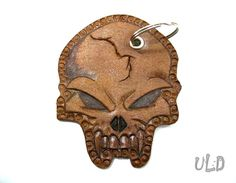 Items similar to Skull leather keychain - Genuine - Hand cut - Hand Tooled - Gothic - Punk - Unique - Different - Design - Die de los muertos - Unisex - Gift on Etsy 3rd Anniversary Gifts, Unique Gifts For Him, Unisex Gifts, Leather Gifts, Gothic Accessories, Leather Keychain, Leather Tooling, Carved Skulls, Fascinating Facts