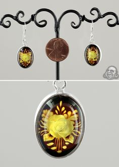 Sterling silver and Baltic amber rose cameo earrings