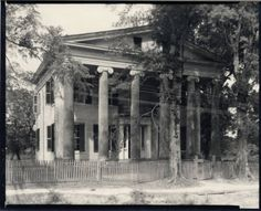 Two story Greek revival with Ionic columns. Henry W. Marston House.  Bank St., Clinton, LA.