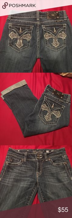 Miss Me Cuffed Capri Beautifully Embellished Miss Me Cuffed Capris. They are a size 29 on the tag but they fit more like a 28 so that is what I am listing them as. They are in like new condition, all embellishments in tact and totally beautiful. Too bad they no longer fit me!! Miss Me Jeans Ankle & Cropped