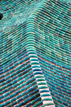 Blue Tile Roof, Guangzhou, China Handmade tiles can be colour coordinated and customized re. shape, texture, pattern, etc. by ceramic design studios