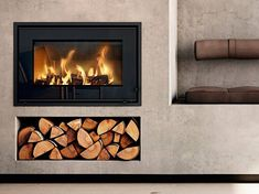 Find your new fireplace in a beautiful design that creates a warm centrepiece in your home. Get Scandinavian quality with a fireplace insert - RAIS Inset Fireplace, Fireplace Showroom, Wood Burner Fireplace, Wood Burning Fireplace Inserts, Modern Fireplace, Fireplace Wall, Living Room With Fireplace, Fireplace Design, Fireplace Surrounds