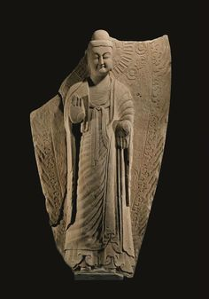 Sandstone standing Buddha, China, Northern Wei dynasty, late 5th to early 6th century
