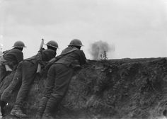 MINISTRY INFORMATION FIRST WORLD WAR OFFICIAL COLLECTION (Q 2553) Soldiers watching shell-bursts, near Bullecourt, 21st June 1917.