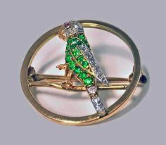 Diamond Ruby Tsavorite Parrot Pin, 20th century | From a unique collection of vintage more jewelry at https://www.1stdibs.com/jewelry/more-jewelry-watches/more-jewelry/