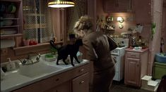 Selena Kyle's Vintage Retro Pink Kitchen in her Super Femme Dainty Gotham City Apartment, this shot in her tiny downtown efficiency is at the beginning of her Cat Woman Transformation....Batman Returns, 1992 with Michelle Pfeiffer, Christopher Walken, Michael Keaton, Danny Devito, Tim Burton