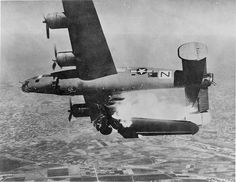 """Camera Captures The Instant A B-24 Bomber's Wing Is Ripped Off By A Direct Flak Hit. Near Bologna, Italy. April 10th, 1945. [[MORE]] According to the loss report, the B-24, nicknamed """"Black Nan,"""" had..."""