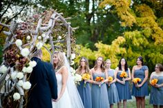 fall background, fall colored bouquets + neutral but organic chuppah