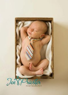 Naked Baby in a box.. with a neck tie.  There is something about this that just gives me the heebie jeebies.