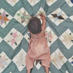 babies on quilts