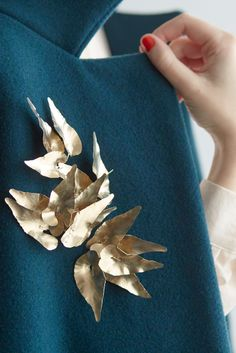 Turquoise Coat, Gold Brooch