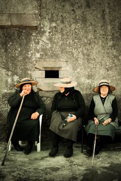 Old ladies sitting at the door of their houses. Watching the time goes by.