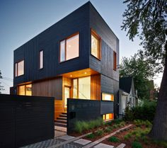 Light and Dark Toronto HomeThe dark facade of this Toronto home in Queen West combined with its light-filled interior, truly make it look like it's lit from within–almost like a light house! The home is topped off with a green room and deck in order to emphasize a connection with the home's outdoor environment. I find that it also nicely echoes the organic, natural nature of the decor inside. The styling is simplicity at its best–lots of white, wood and carefully placed skylights...