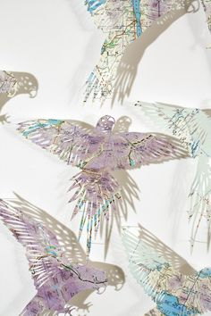 Here is my lovely piece, On a Secret Mission. It is hand cut from an RAF map of Scotland. I just love the colours, they are quite unusual in maps, purple is not a common colour, and I think that ma…
