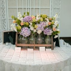 A myriad collection of flowers for the centerpieces - so lovely! 44 Loveliest #Lavender #Wedding #Details