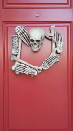 My version of the skeleton wreath, made with a $16 bag of bones from a Spirit Halloween store, Styrofoam glue, and finishing nails