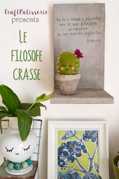 """Handmade felted cute cactus, standing on a concrete handmade shelf and vase having a quote for you. From craftpatisserie"""" le filosofe crasse"""" (philosopy cactus)"""