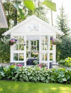 A light and airy greenhouse in white.