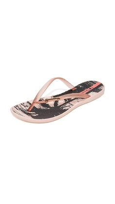 4049e2400 Ipanema Women s Wave Postcard Flip Flops  A tropical graphic accents the  textured footbed on these casual rubber Ipanema flip-flops.