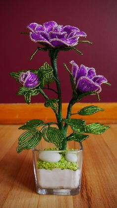 Handmade item. These flowers are made of seed beads and bugle beads, framed with stem wire and finished with floral tape. The roses are attached to the vase and fixed using Plaster Of Paris