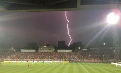 Lightning strikes during a Gambrinus liga game between Zbrojovka Brno and Sparta Praha in Brno on August 4th, 2013. Four Brno fans were injured by a falling tree in the storm. Photo: Ondřej Eisner