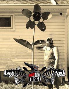 Shovel Art Flower made with broke shovels. Leaves cut from metal 55 gal drums.