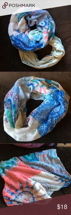 Infinity scarf bundle of two! Great addition to any scarf lovers collection! Solid color is a soft mint from Talbots never worn & in new condition. Multi color scarf has various shades of blue, green and pink - no brand. There is a pull that runs from one side to the other (see picture). The pull is not noticeable when you're wearing it. Talbots Accessories Scarves & Wraps