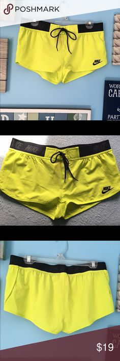 Nike Running Shorts in Neon Yellow Nike running shorts that were meant to be worn! NWOT. Size small and just a bit too small for my liking, which is why I want you to have them! They're a little sheer and could be worn with spandex. Neon yellow with black waistband and ties. Nike Shorts