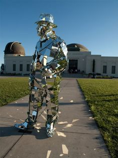 Mirror Man standing in front of the Griffith Observatory in LA is not a sculpture, but German artist Gustav Troger clad in an armor of mirrors. http://www.gustavtroger.com/