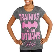 The Stir-Moms Freaking Out Over 'Batman's Wife' T-Shirt Need to Get a Life|Someone found a shirt in the junior's department at Walmart and flipped out, because apparently it set the feminist movement back about 70 years. The shirt in question suggests that a girl might actually someday want to have a kickass husband.  It seems that one wannabe Batgirl was looking through the racks when she spotted a pink Batman symbol. She was horrified to find that the T-shirt read.......