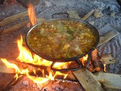 Paella cooked on open fire. Hey Miki....backyard BBQ one of these days?