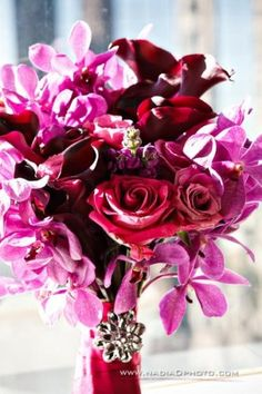 purple, maroon, and pink bouquet. I could replace some of the purple and pink with white and silver.