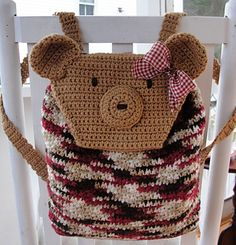 How much will your child girl LOVE our Teddy Bear Backpack? You can crochet our adorable backpack using easy-to-find materials and quick stitches! Omit the ribbon on the backpack and crochet it for your little boy! The bear head is the flap of the backpack! Roomy backpack will hold all your children's treasures or books from school.