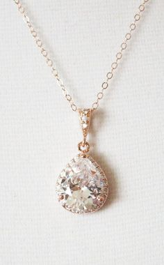 Might be a good choice to wear for wedding day depending on dress neckline. Rose Gold Luxe Cubic Zirconia Teardrop Necklace