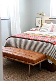 lovely leather bench at the end of the bed.