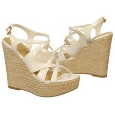 Kick your rockin' style up a notch in the white INDIE wedges from Fergie.
