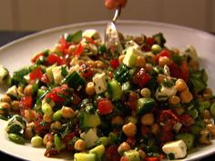 Middle Eastern Vegetable Salad recipe from Ina Garten via Food Network - REALLY yummy! Very similar to a Greek salad but with mint to give it something extra Middle Eastern Salads, Middle Eastern Recipes, Middle Eastern Vegetarian Recipes, Food Network Recipes, Cooking Recipes, Healthy Recipes, Cooking Ideas, Easy Recipes, Healthy Corn