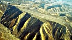 One of the World's Greatest Mysteries   What happened to the mountain tops in Nazca, Peru?   Some of the mountain tops look as if they were completely cut off, as if someone had sliced off the top of the mountain with a near perfect cut