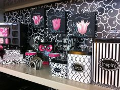 Te wallpaper is a little too busy, but i like the canisters and the pictures.  Cubicle decor, tulips