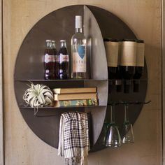 Geometric serving bar mounts flush to the wall with extended and separated shelves, wine and glass racks. There's even a towel holder. This is both an architectural accessory and a space saving sensor...