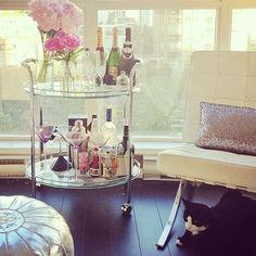 Love this bar cart : ] but so would my dogs....no one wants dust in there! Oh well....